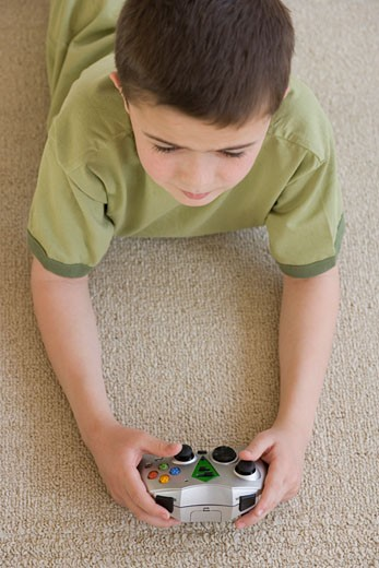 Stock Photo: 1795R-6858 Boy playing video games
