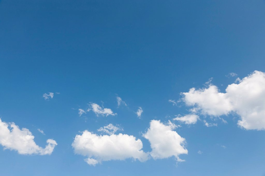 Blue sky with puffy clouds : Stock Photo
