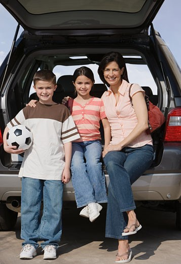Stock Photo: 1795R-6867 Mother and children on tailgate of truck