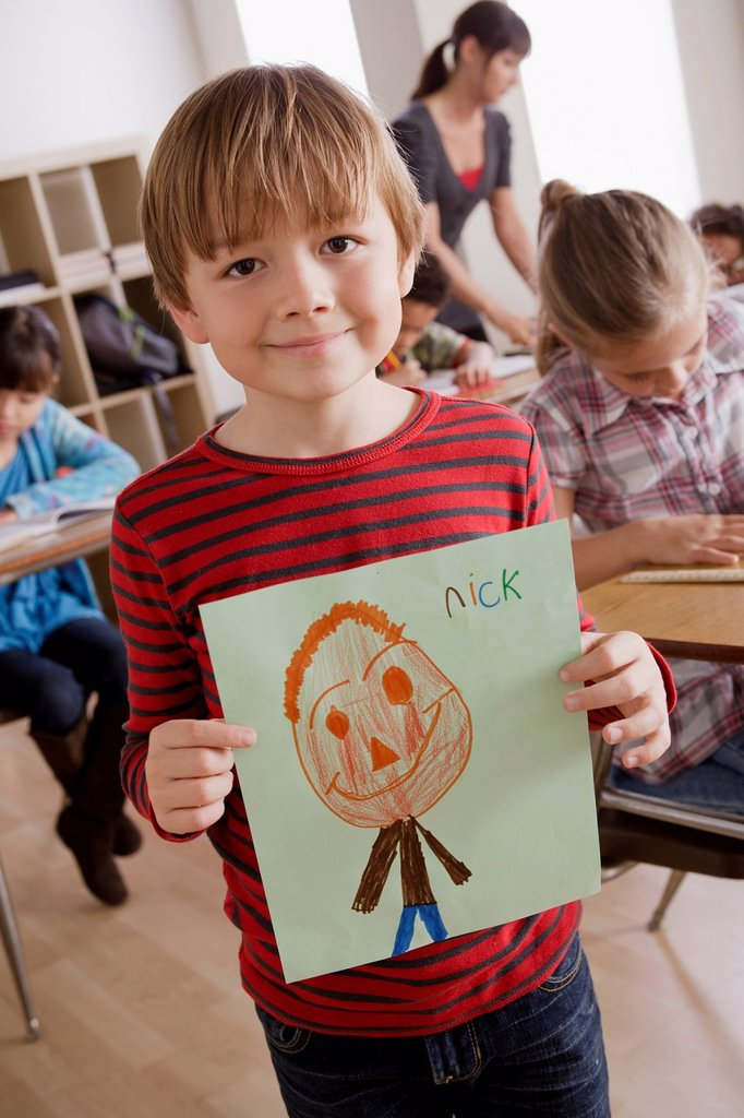 Boy 6_7 showing his drawing : Stock Photo
