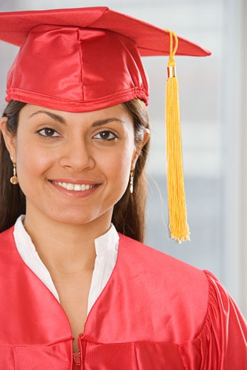 Indian woman wearing graduation cap and gown : Stock Photo