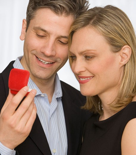 Stock Photo: 1795R-6935 Couple looking at ring box