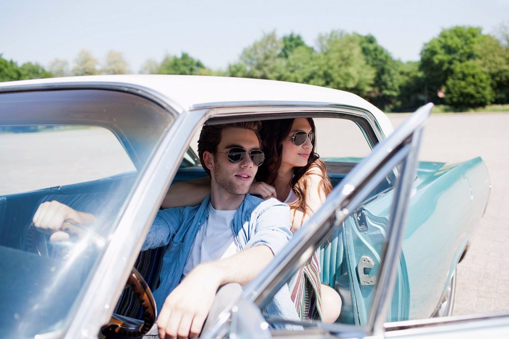 Stock Photo: 1795R-69951 Couple in vintage car