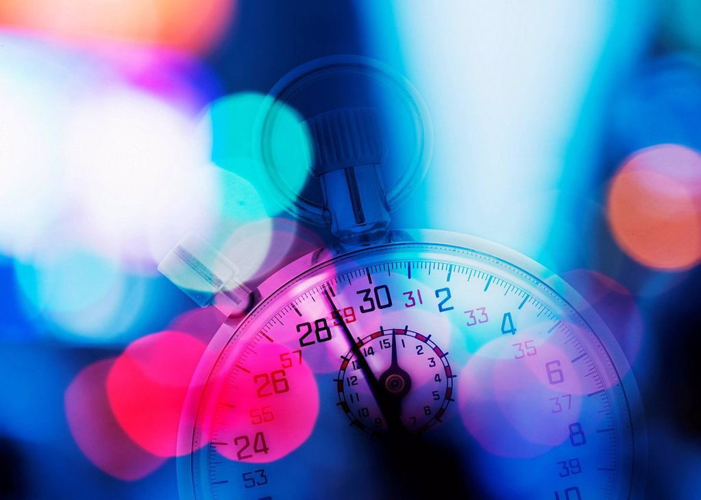 Stopwatch and colorful lights : Stock Photo