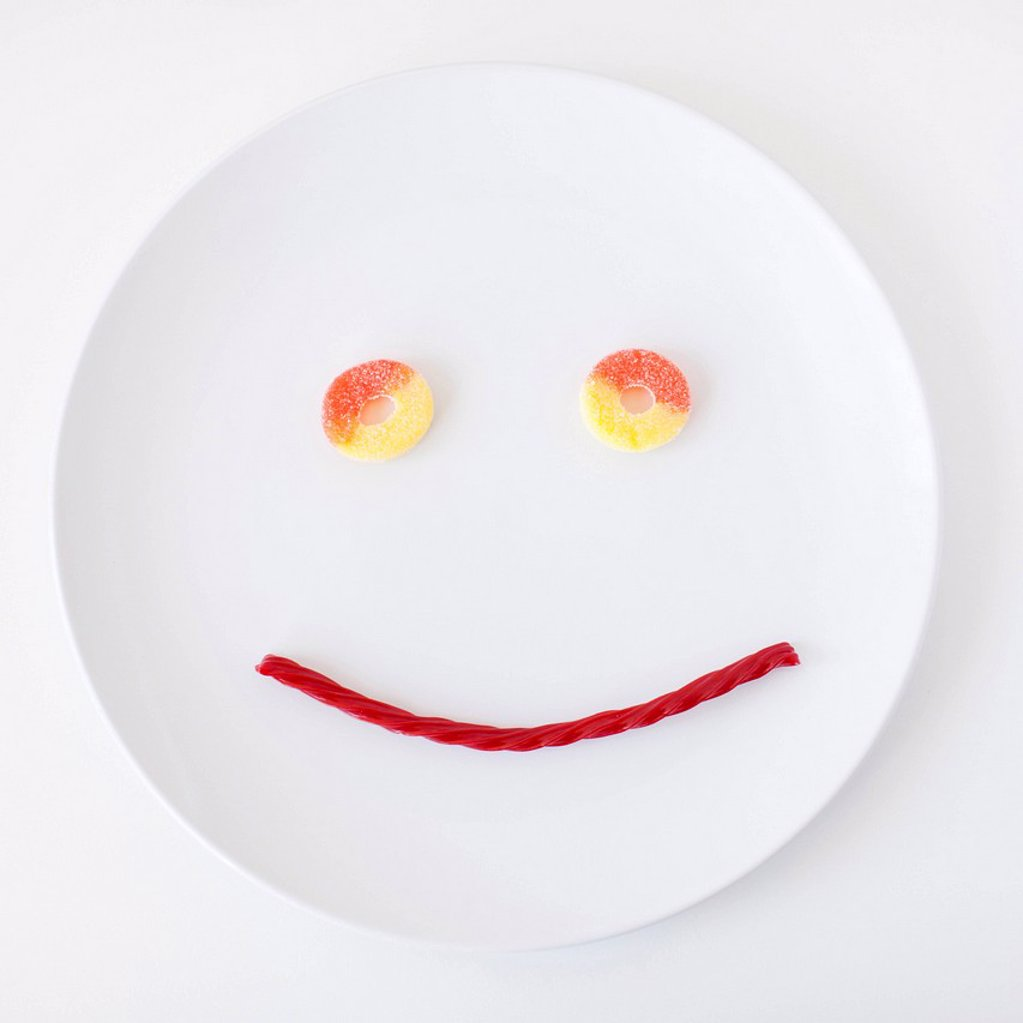 Smiley face on plate made out of jelly beans : Stock Photo