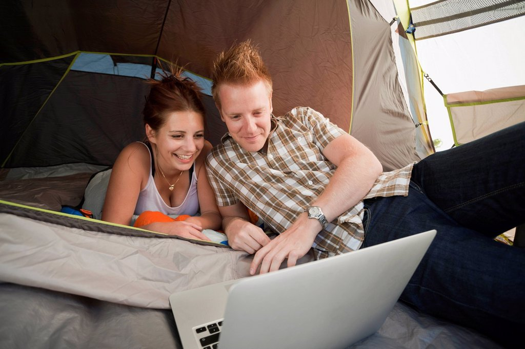Stock Photo: 1795R-70440 Hikers in tent using laptop