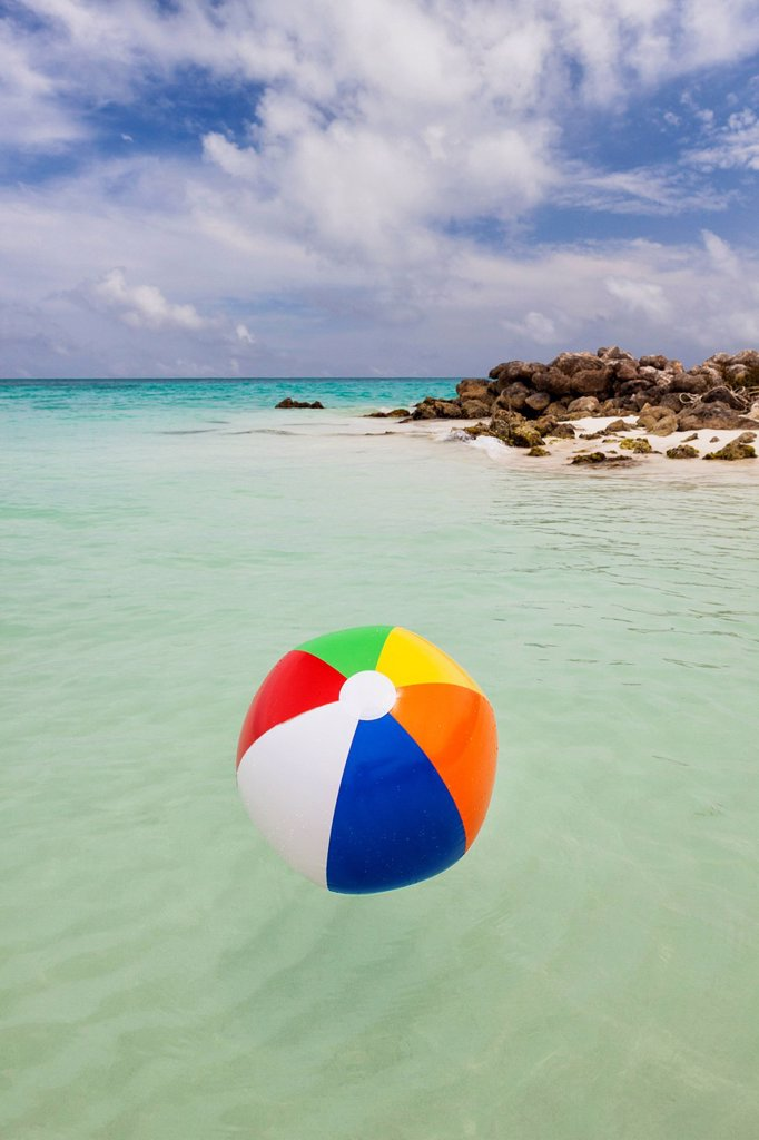 Stock Photo: 1795R-70461 Mexico, Quintana Roo, Yucatan Peninsula, Cancun, Beach ball floating on sea