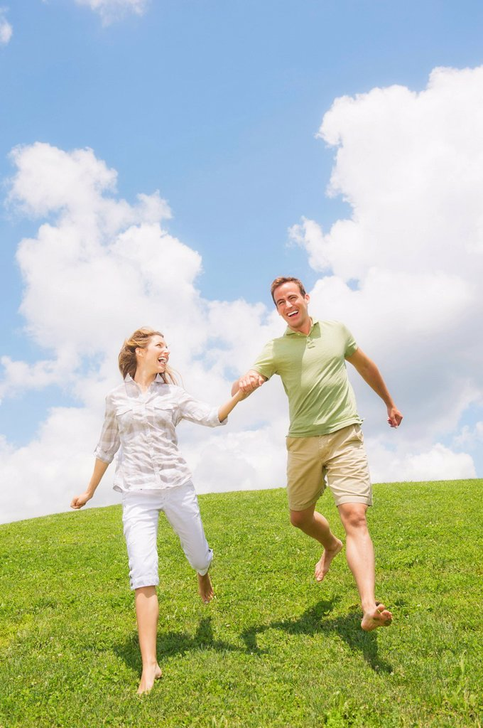 Stock Photo: 1795R-70637 Couple running on grass