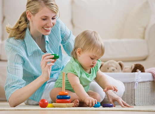 Mother and baby playing on floor : Stock Photo