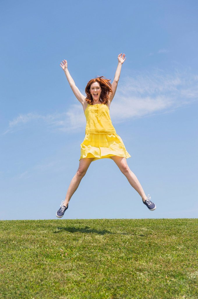 Stock Photo: 1795R-70812 Woman jumping on meadow