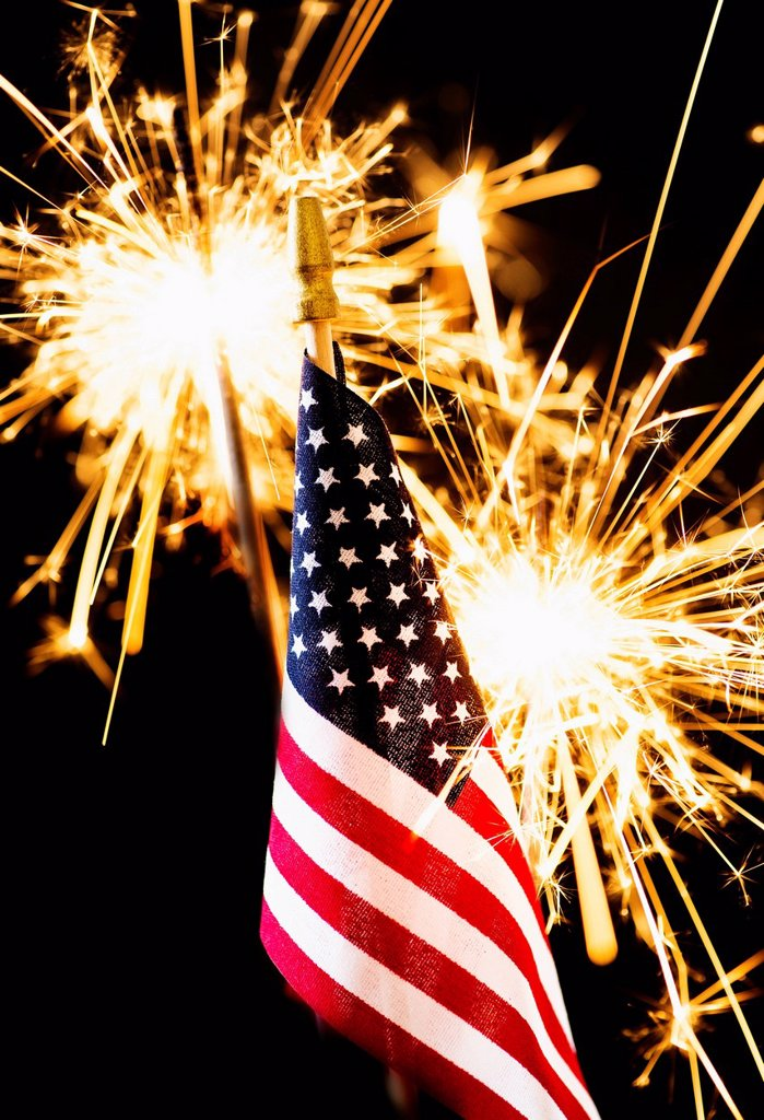 Stock Photo: 1795R-70929 Sparkler and American flag an black background