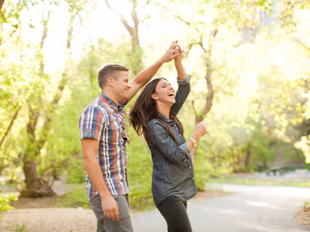 Stock Photo: 1795R-71137 Young couple dancing togetherness in park