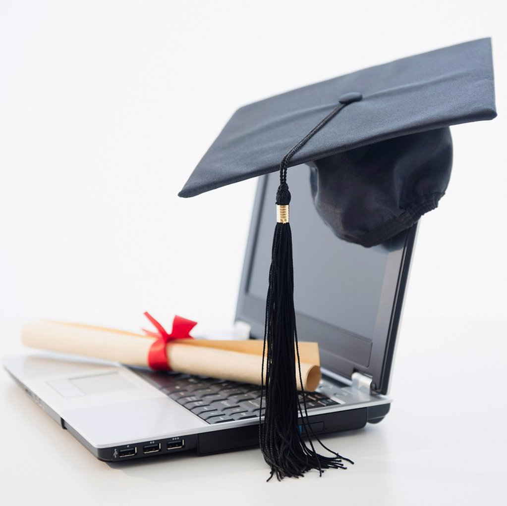 Laptop with diploma and mortar board : Stock Photo