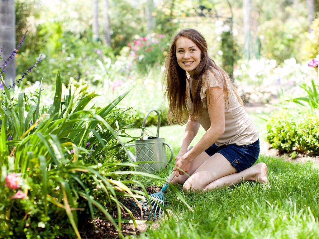 Stock Photo: 1795R-71385 Portrait of young woman in garden