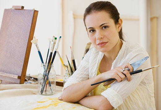 Stock Photo: 1795R-7174 Female artist in painting studio