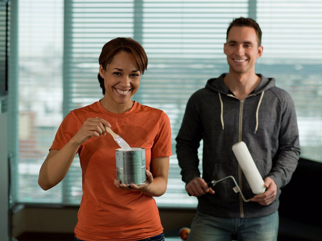 Young couple preparing for painting their home : Stock Photo