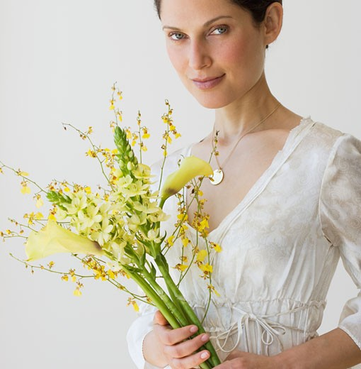 Stock Photo: 1795R-7233 Woman holding bouquet of flowers