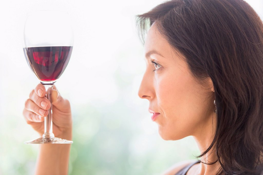Stock Photo: 1795R-72611 Woman tasting red wine