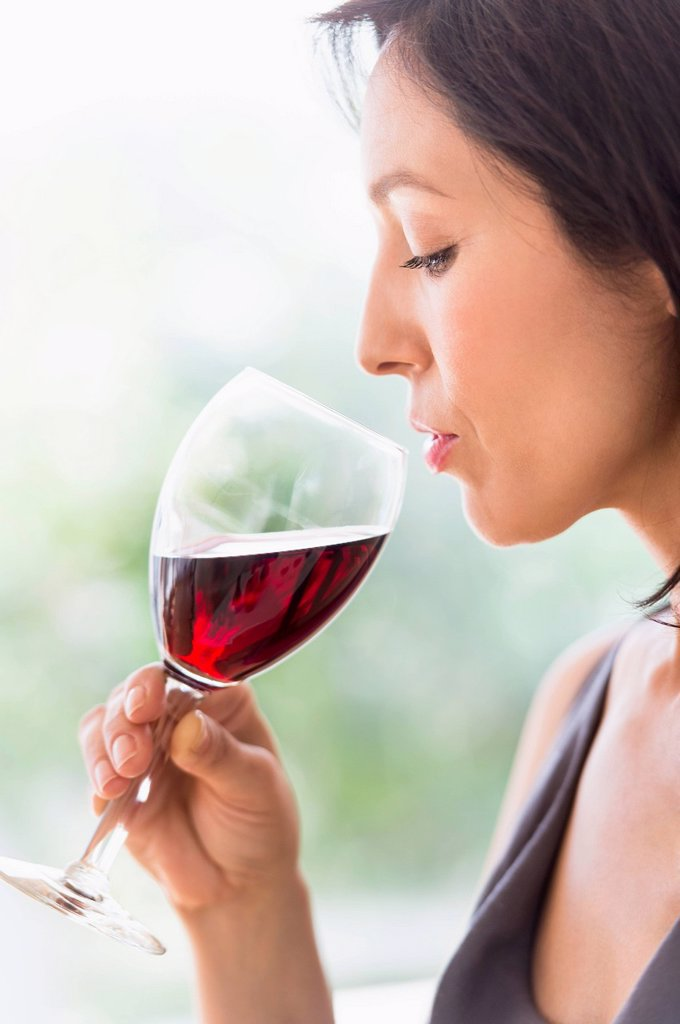 Woman tasting red wine : Stock Photo