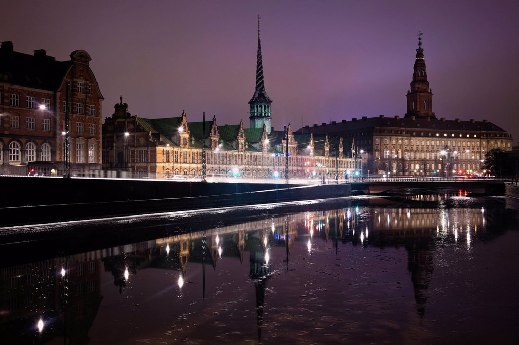 View over canal towards Copenhagen Stock Exchange and Christiansborg Castle : Stock Photo