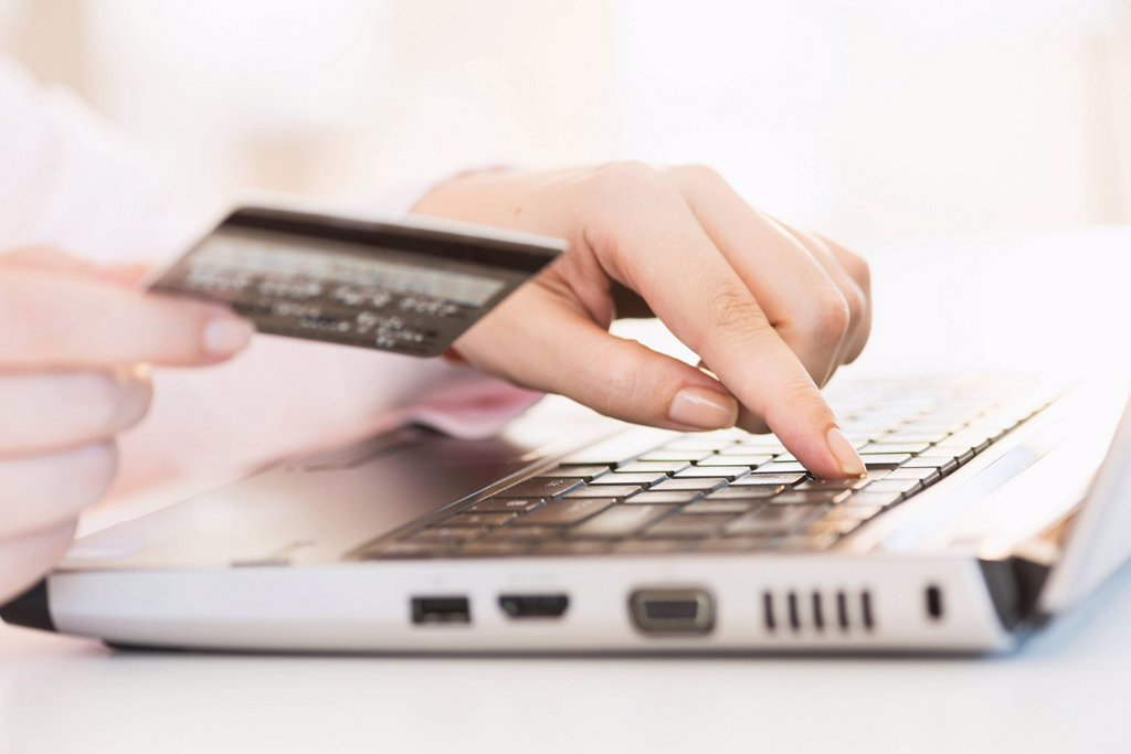 Stock Photo: 1795R-74913 Close up of woman´s hand doing online banking with laptop