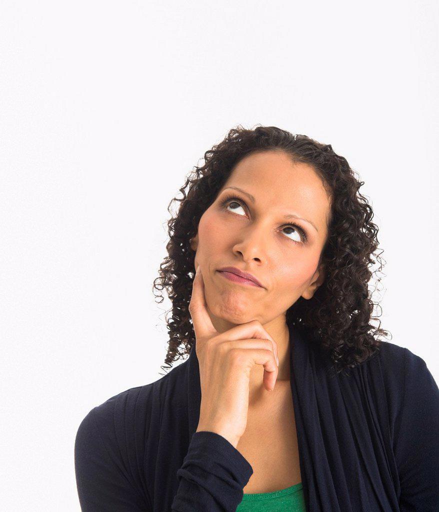 Stock Photo: 1795R-74993 Studio shot of woman contemplating