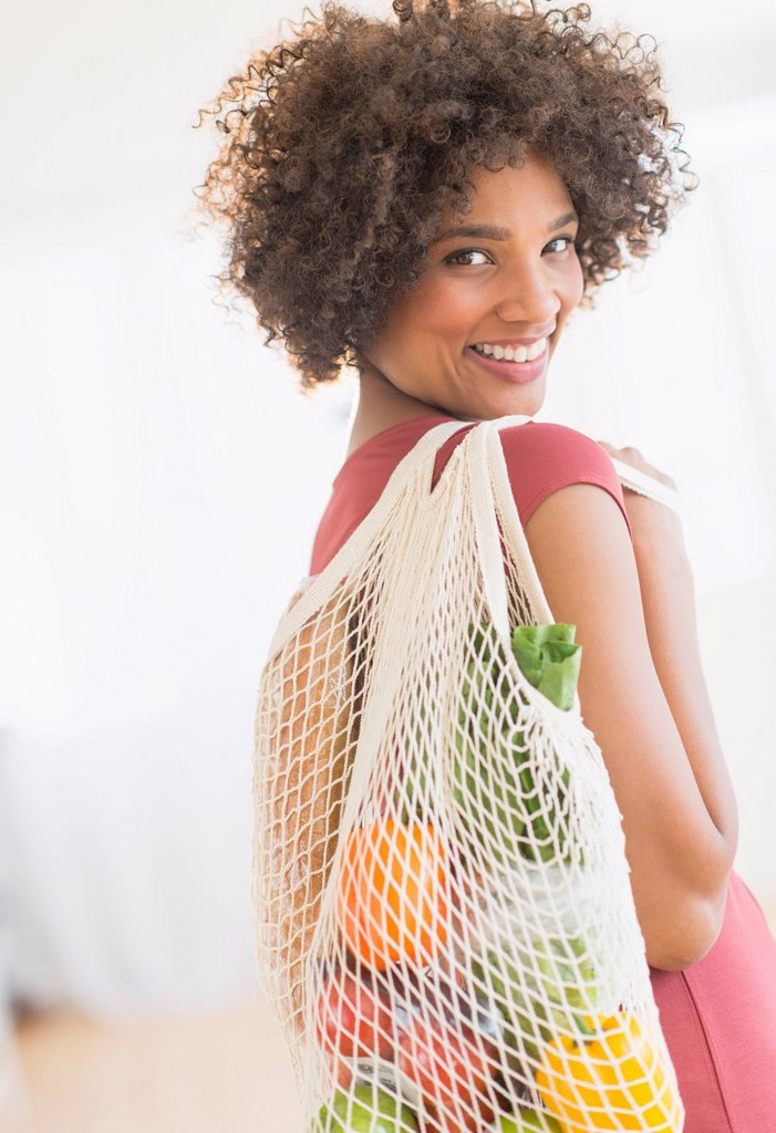 Stock Photo: 1795R-75107 Portrait of woman carrying grocery bag