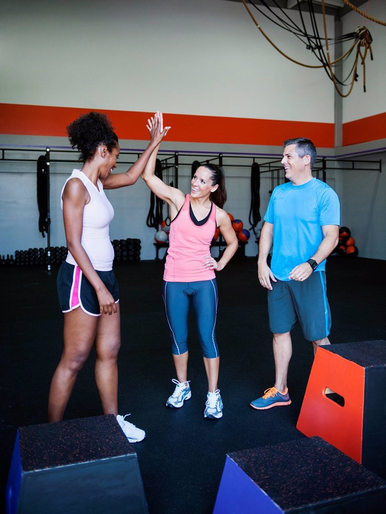 Three people after step aerobics class : Stock Photo