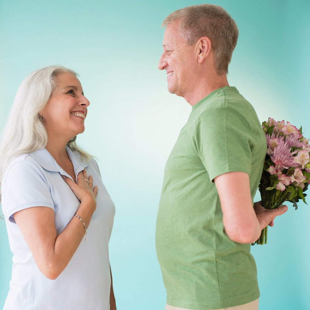 Stock Photo: 1795R-76692 Man giving bouquet to woman