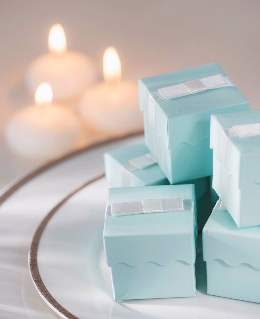 Pastel composition with gifts packages and candles : Stock Photo