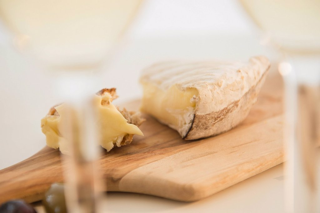 Studio shot of cheese on chopping board : Stock Photo