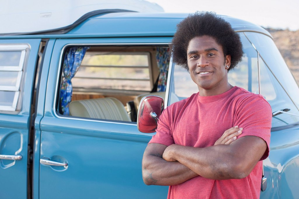 Stock Photo: 1795R-77639 Man in front of his mini van during road trip