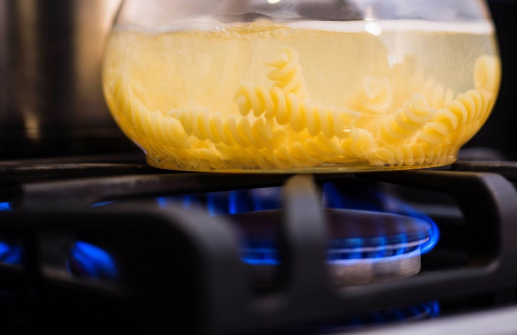 Stock Photo: 1795R-77749 Close_up of pasta boiling on gas burner