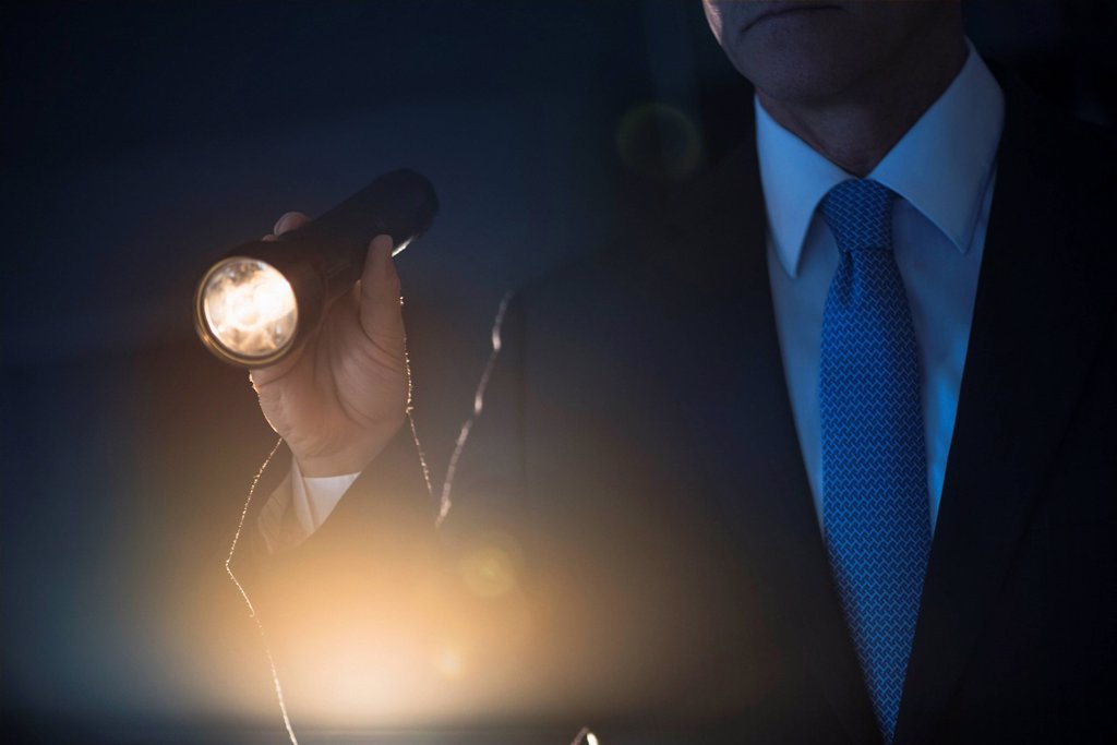 Businessman holding flashlight : Stock Photo