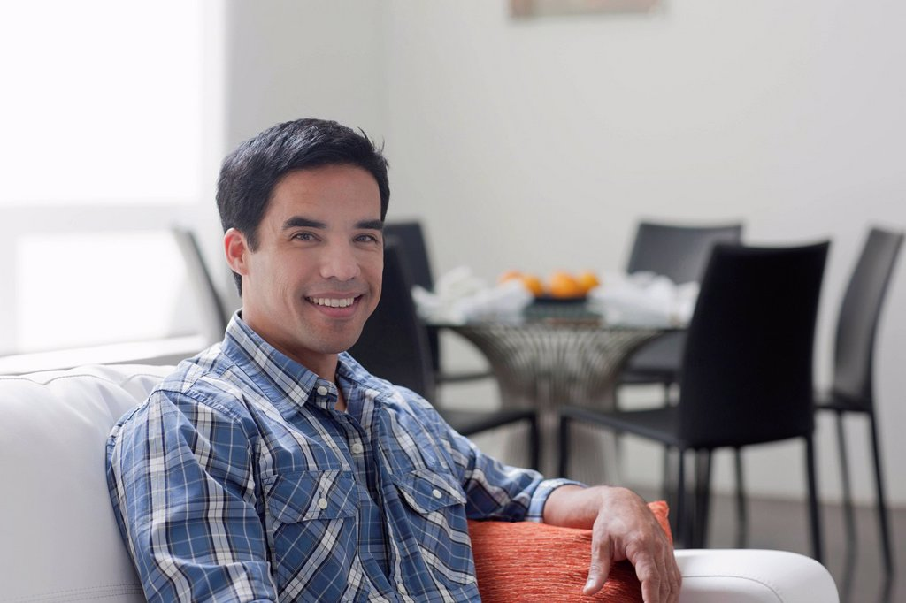 Stock Photo: 1795R-79503 Portrait of man sitting in living room