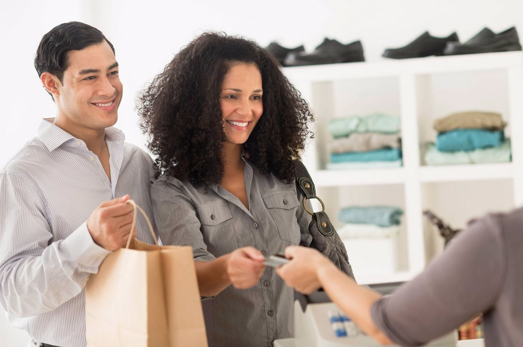 Stock Photo: 1795R-80040 Customers and sales clerk in store