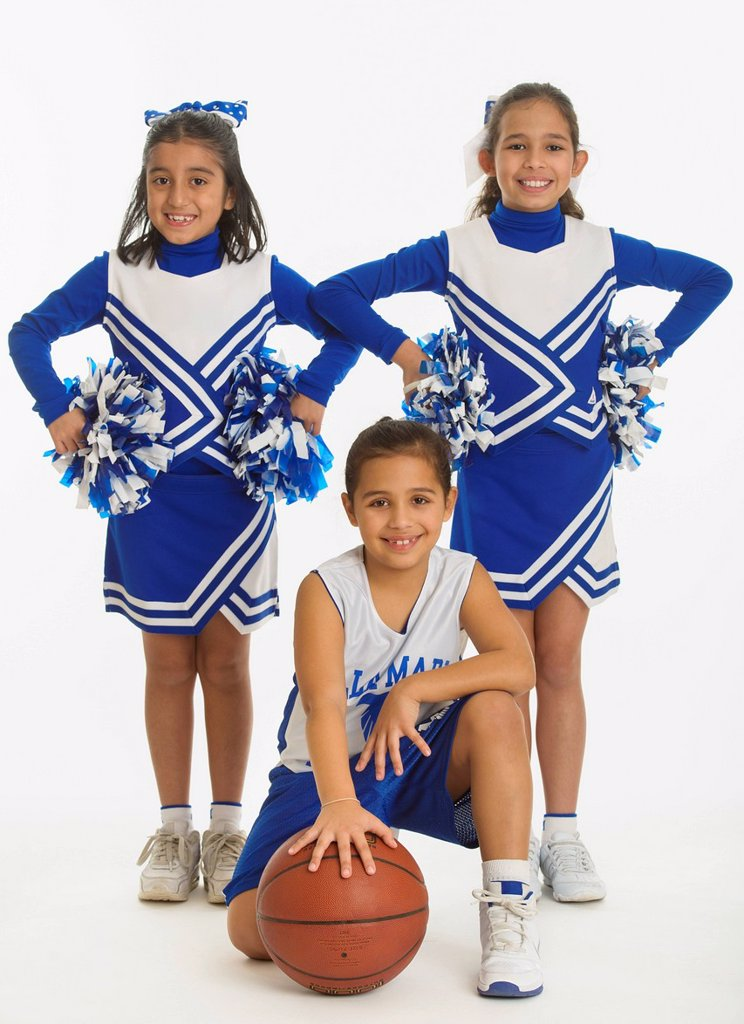 Stock Photo: 1795R-80480 Portrait of cheerleaders 8_9 years  10_11 years holding pom_pom and ball