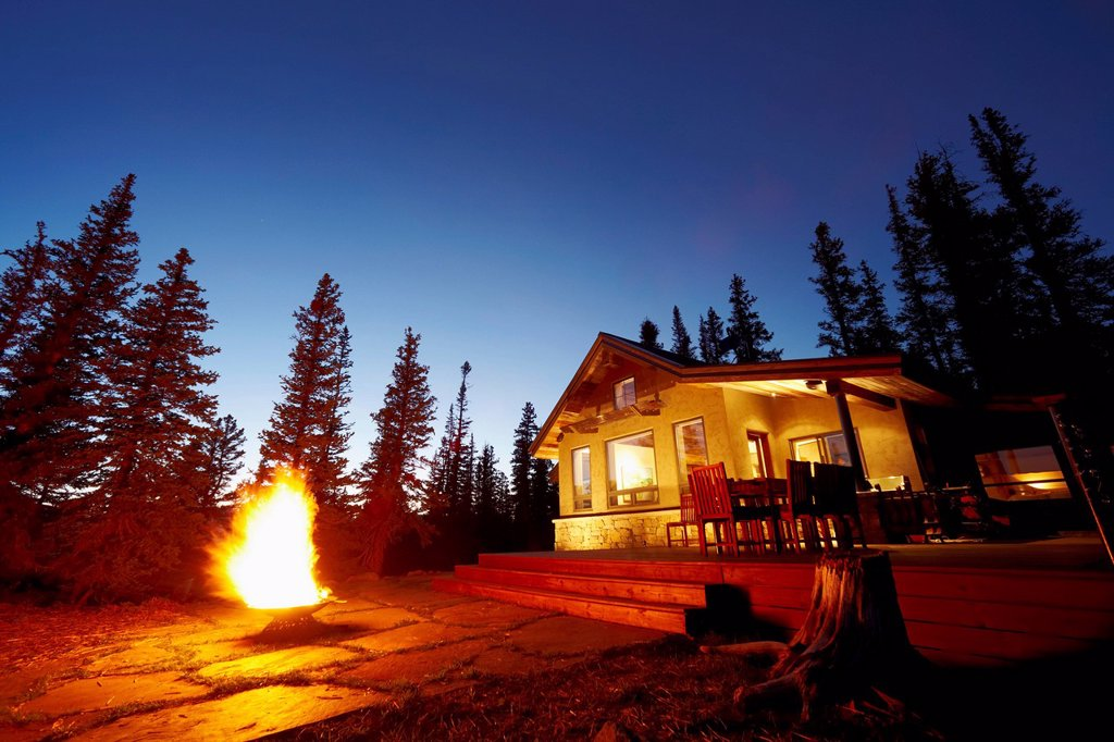 Fire pit in front of house : Stock Photo