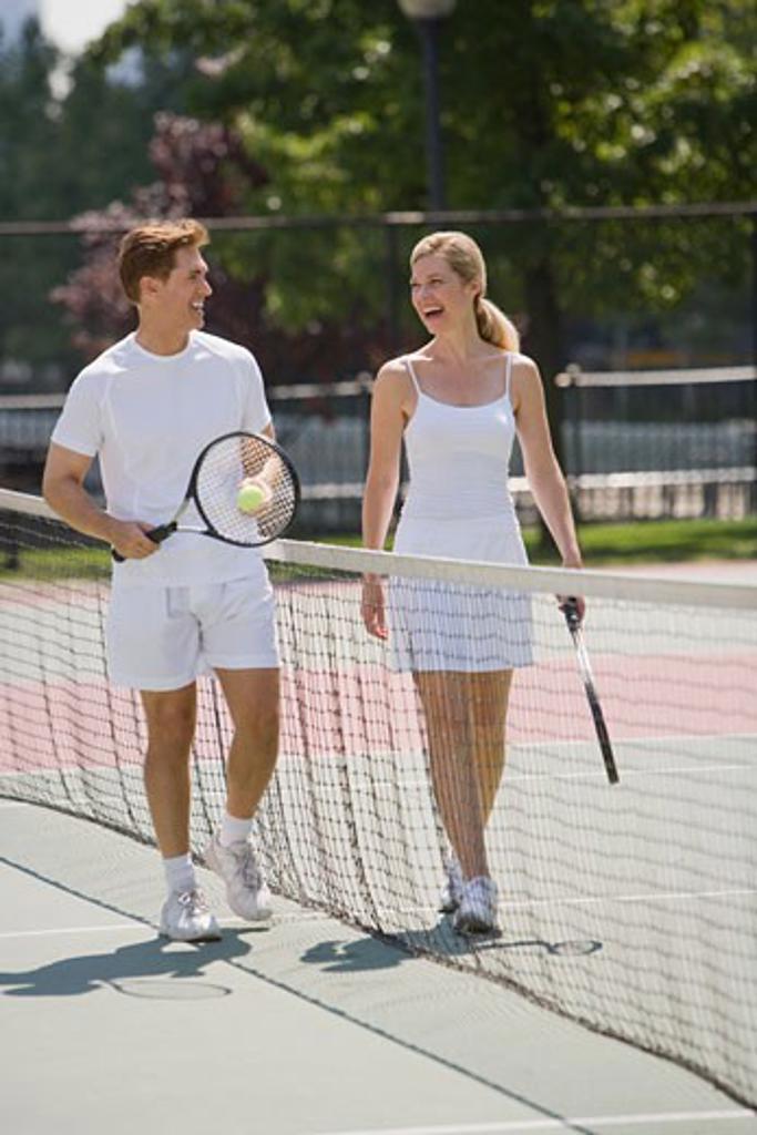 Stock Photo: 1795R-8084 Couple on tennis court