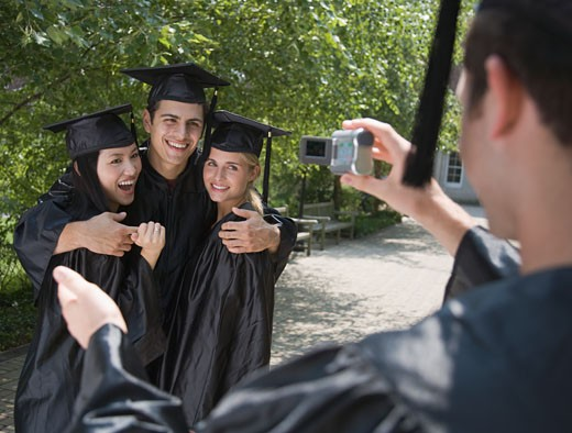 Group of college graduates having photograph taken : Stock Photo