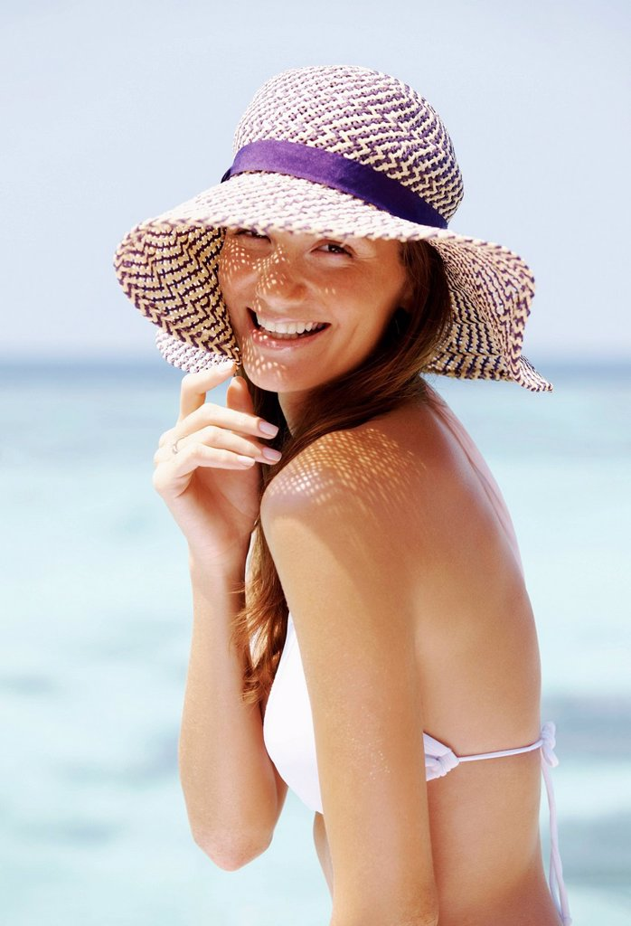 Portrait of young woman in bikini and straw hat : Stock Photo