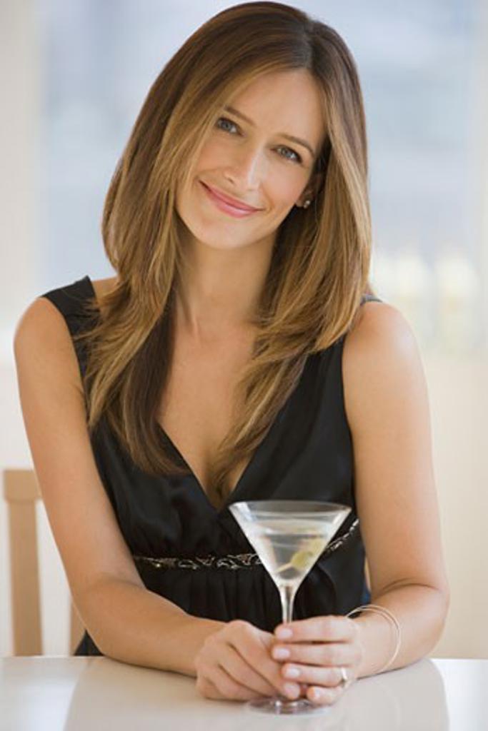 Woman drinking martini : Stock Photo