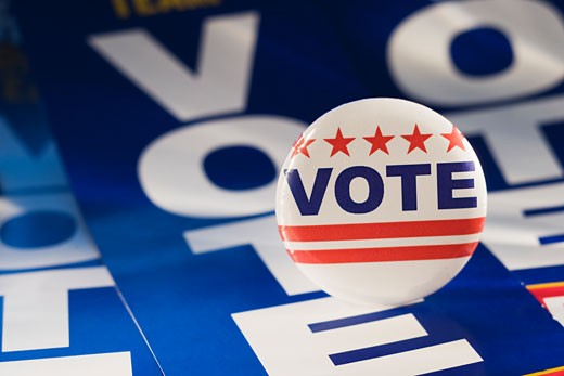 Stock Photo: 1795R-8934 Close up of Vote button on Vote banners