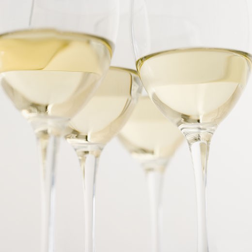 Glasses of white wine seen from below : Stock Photo