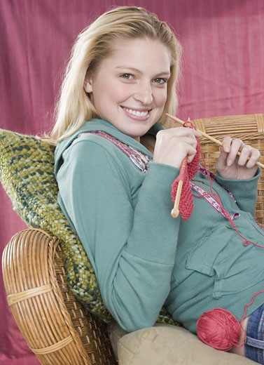 Stock Photo: 1795R-9234 Portrait of woman knitting