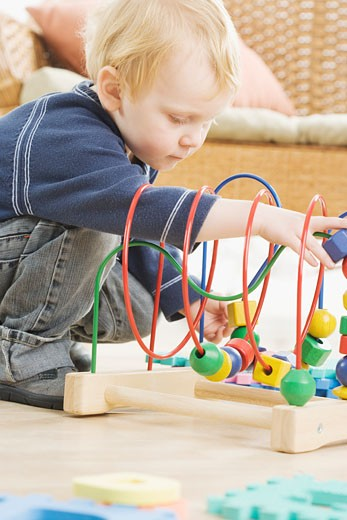 Young boy playing with block toy : Stock Photo