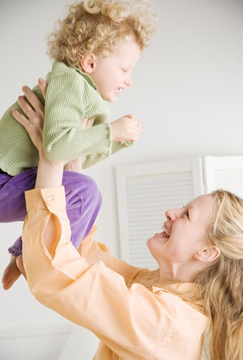 Stock Photo: 1795R-9374 Mother playing with her daughter
