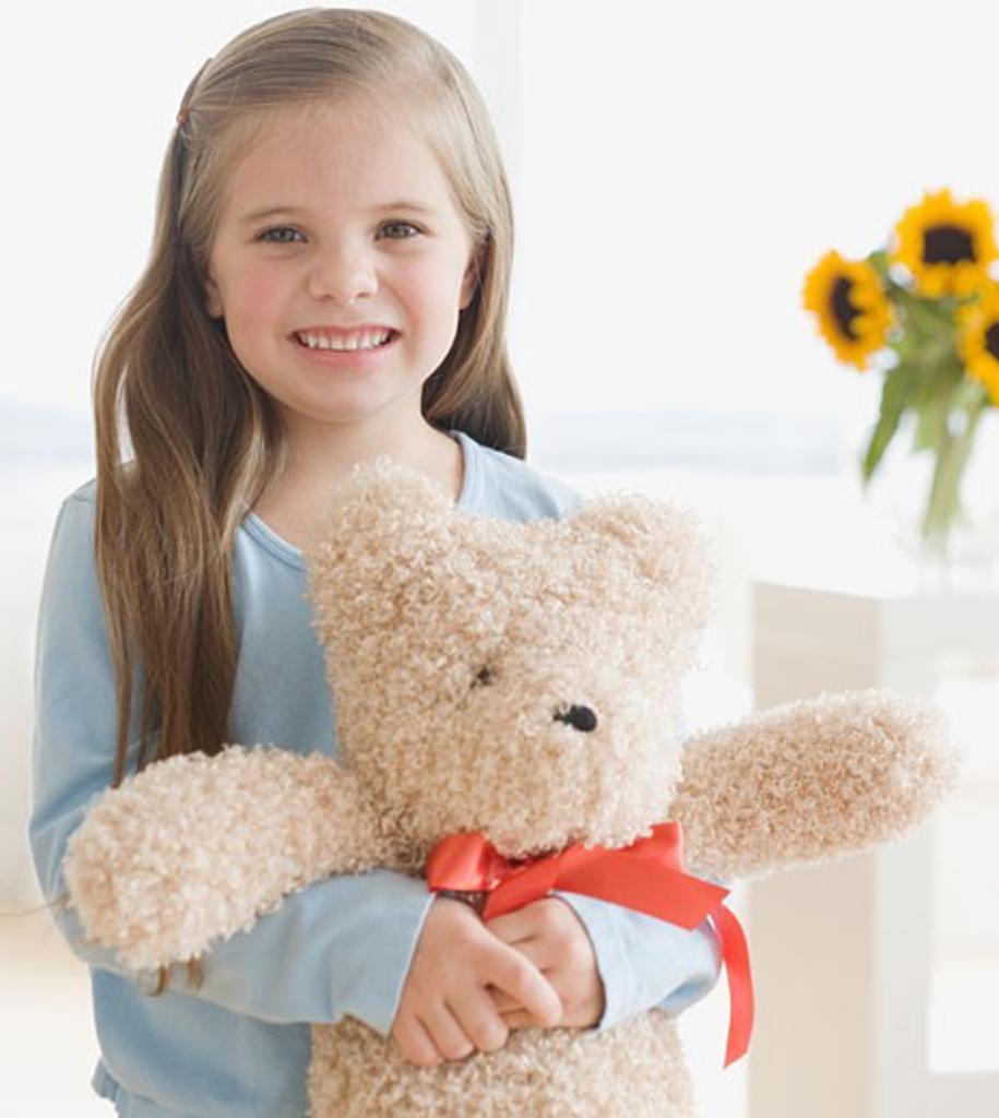 Portrait of girl hugging teddy bear : Stock Photo
