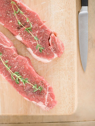 Stock Photo: 1795R-9601 High angle view of meat and spices on cutting board