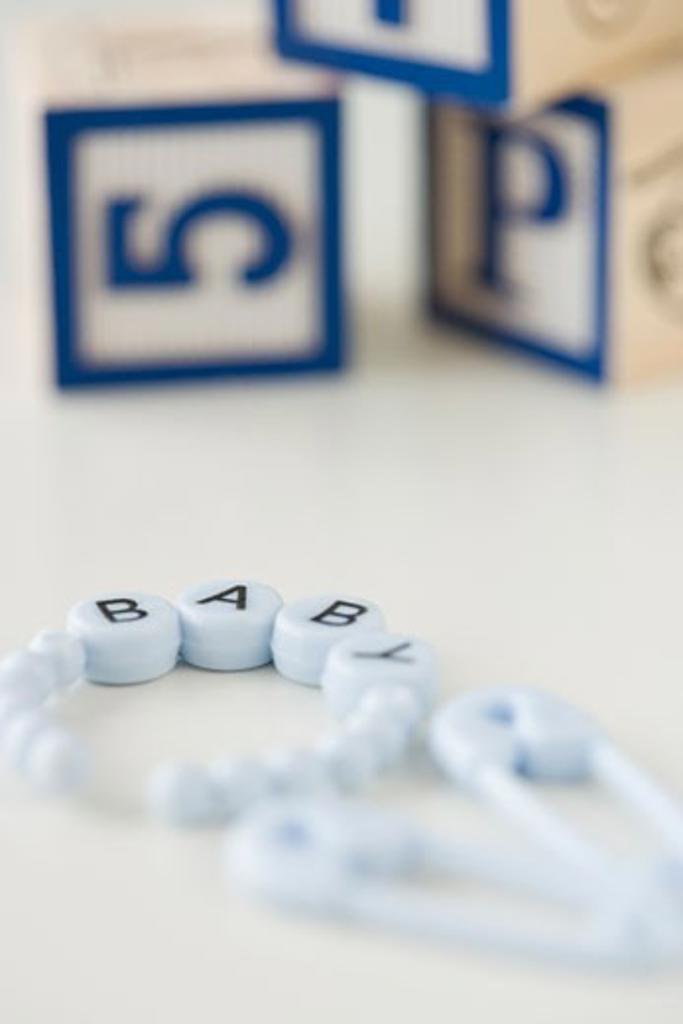 Baby bracelet and blocks : Stock Photo